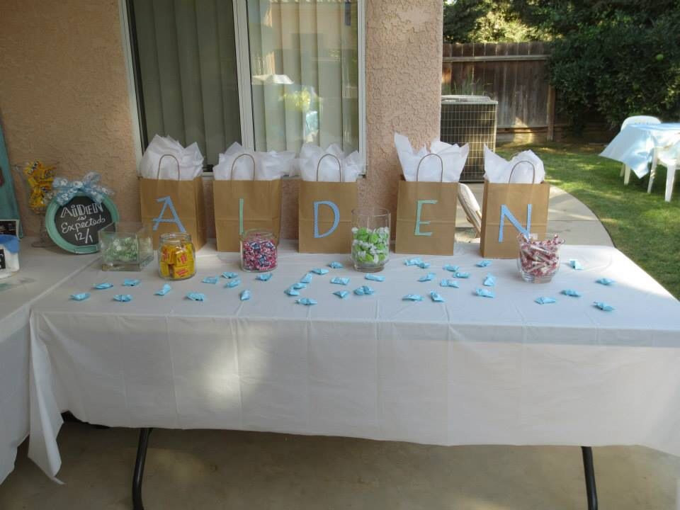 Baby Shower Gift Ideas For Games  Gifts for baby shower game winners with candy scattered