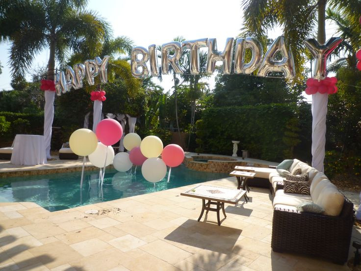 Backyard 21St Birthday Party Ideas  Birthday balloon arch over a swimming pool Backyard party
