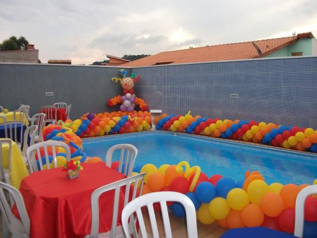 Cheap Pool Party Ideas  Colorful balloon garland to decorate the pool for a kids
