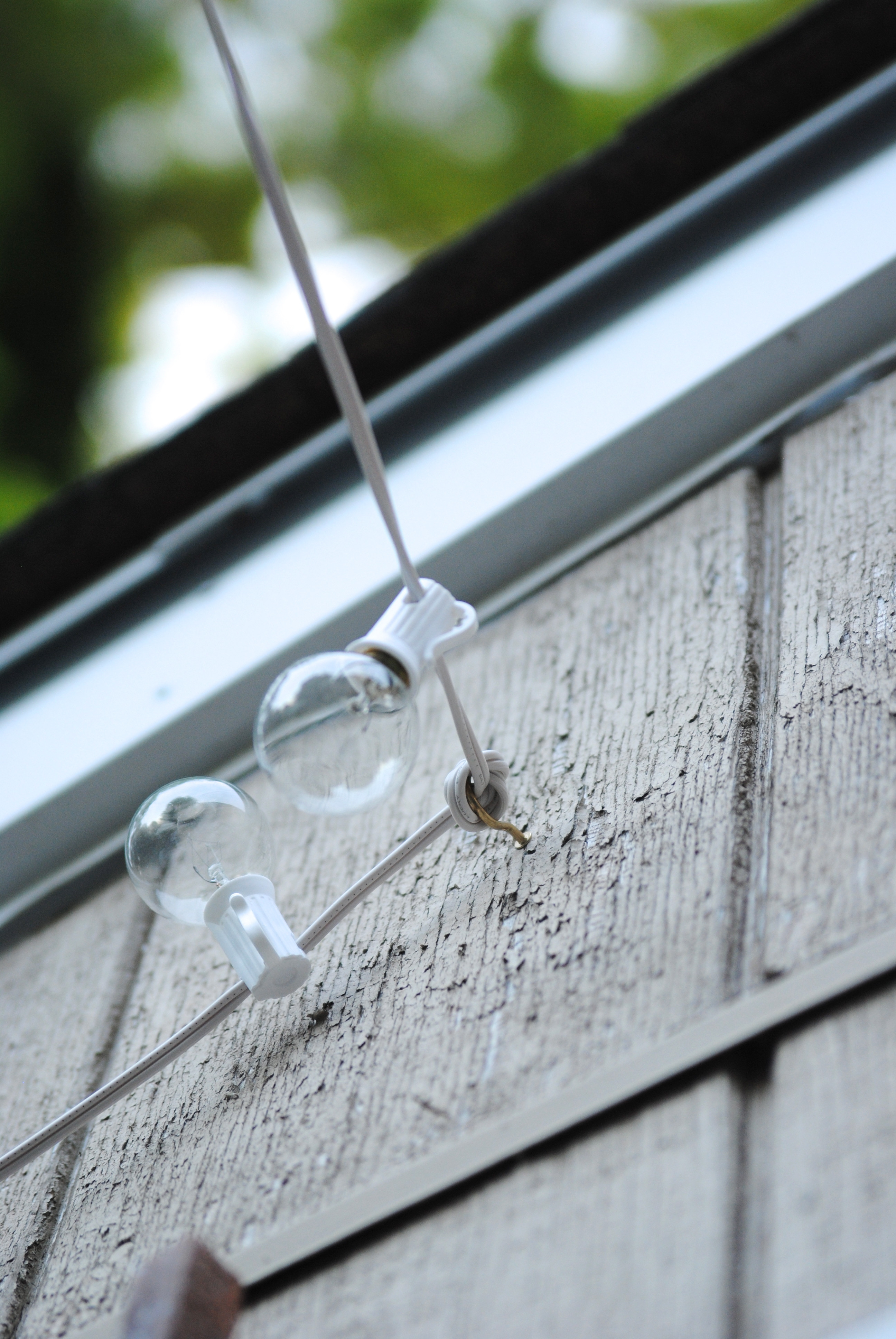 DIY Outdoor String Lights  How to Hang Outdoor String Lights The Deck Diaries Part