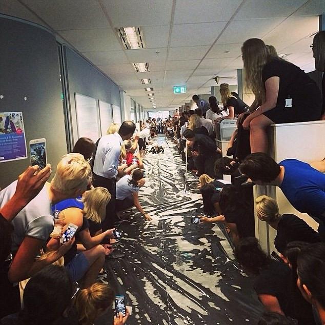Fun Work Christmas Party Ideas  Colleagues in Brisbane create Slip n Slide in their