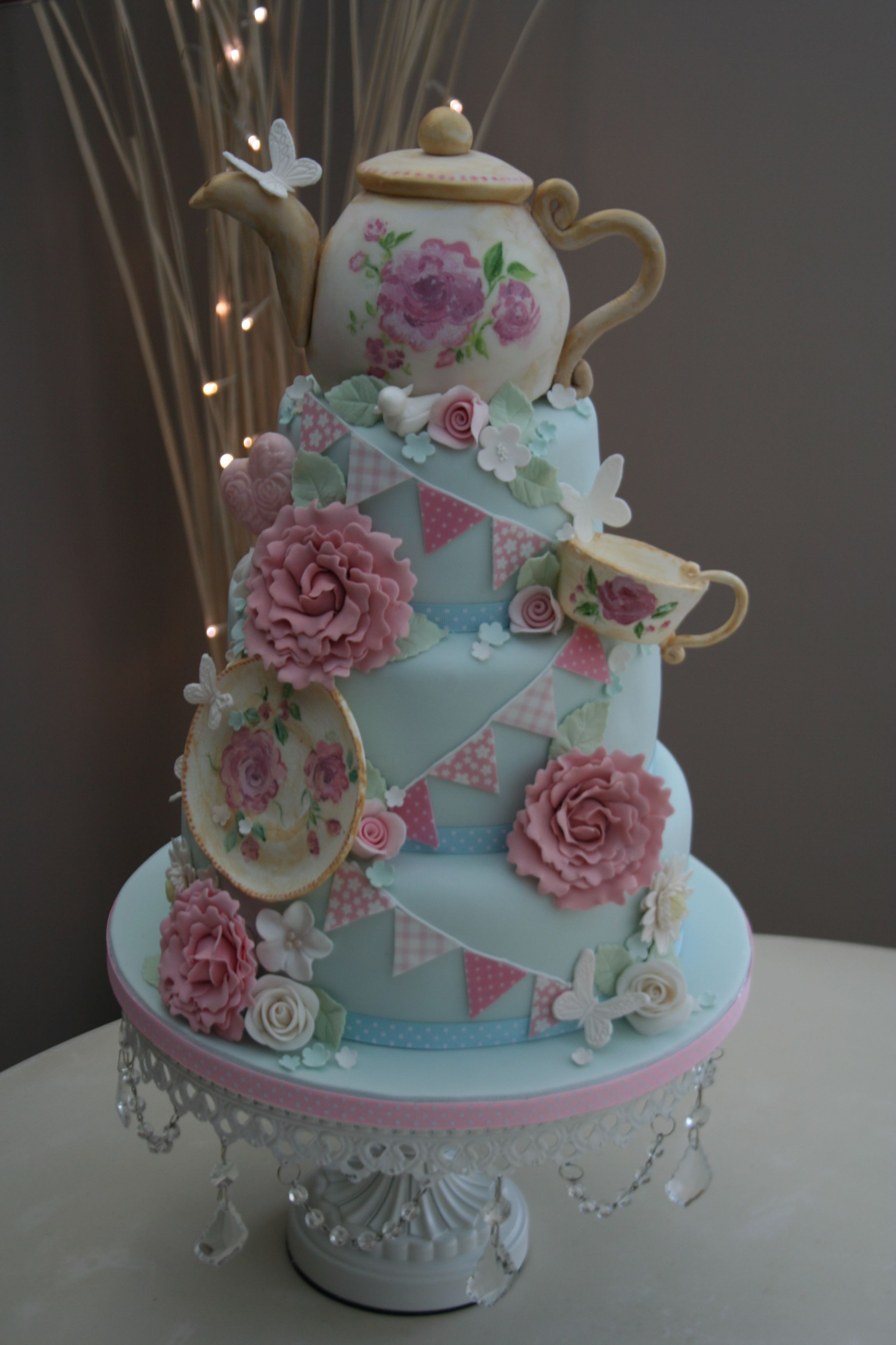 Tea Party Cake Ideas  Pretty colors and I like the flowers tea items but I d