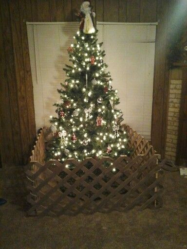 Christmas Tree Fence Indoors  Toddler proof your Christmas tree i would decorate the
