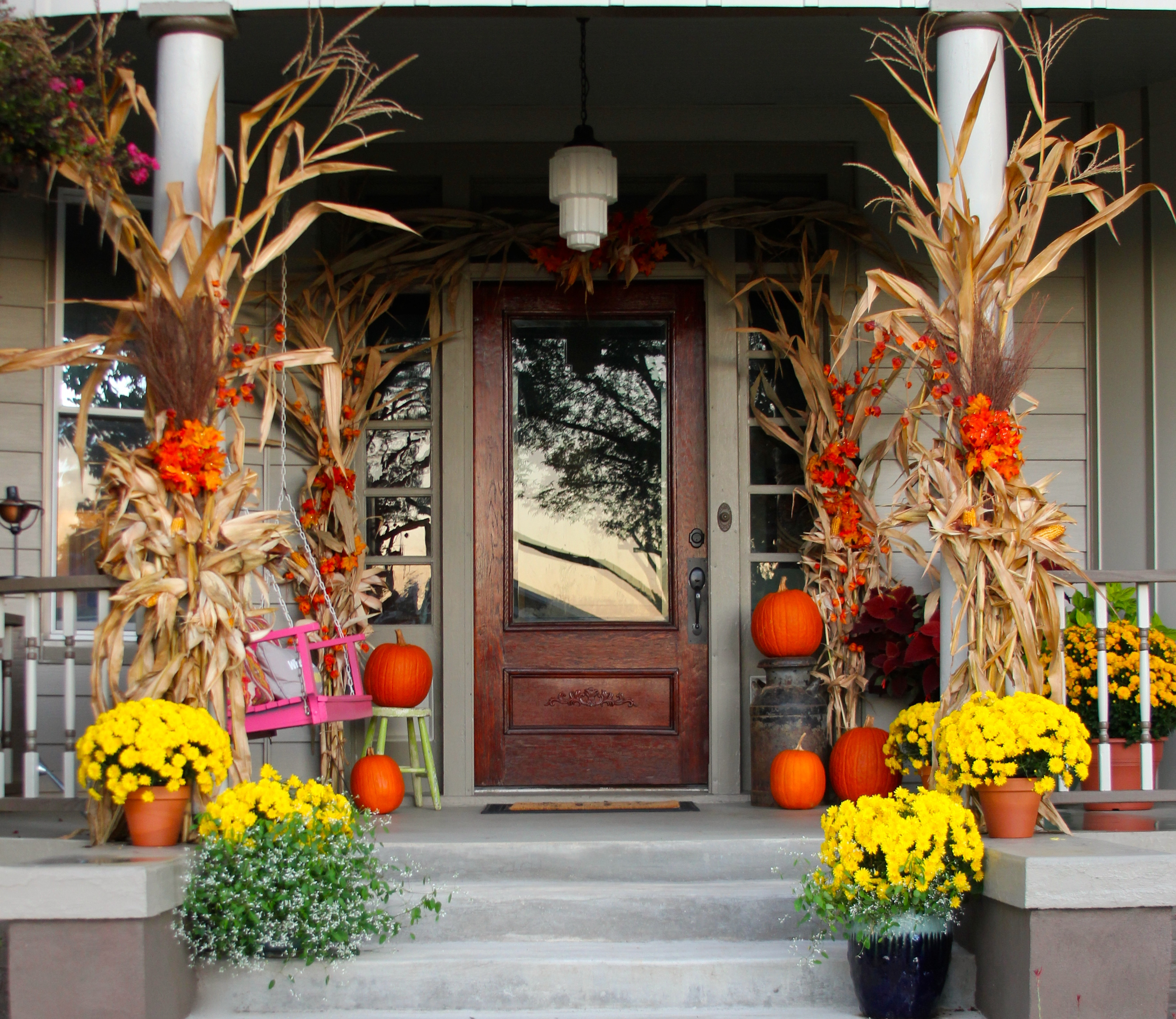Front Porch Fall Decorations  decorating with a milk can