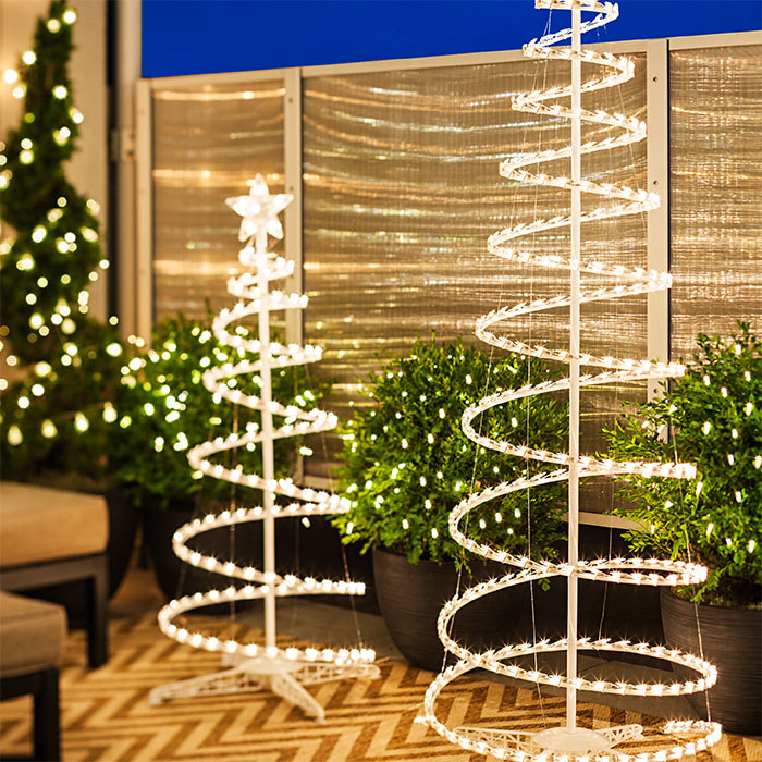 Outdoor Spiral Christmas Trees  6 Christmas Lighting Ideas for a Porch Deck or Balcony